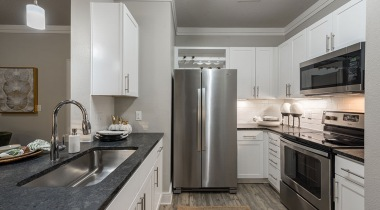 Luxury Sanford apartment kitchen with stainless steel appliances