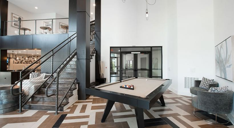 Resident clubhouse with pool table in Fort Worth, TX