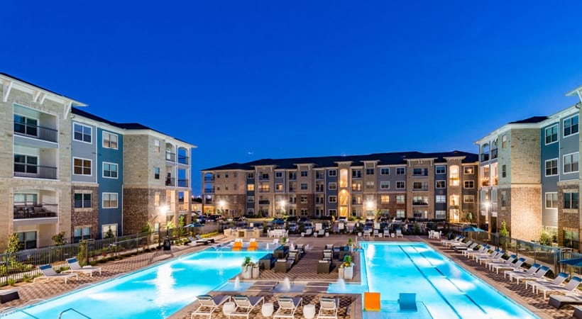 Poolside lounges at our Craig Ranch apartment pool
