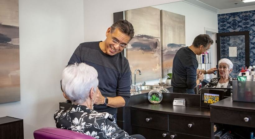 Resident getting her haircut at our onsite salon at Attiva Central Park - 55 plus apartments in Grand Prairie