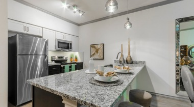 Modern apartment kitchen with sleek granite countertops