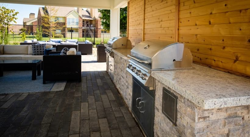 Outdoor lounge with gas grills at Attiva Lewisville