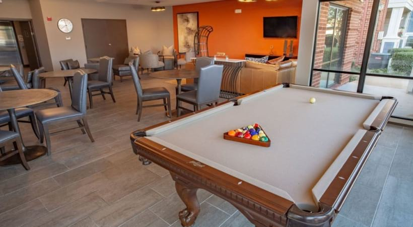 Resident clubhouse with pool table at Attiva Lewisville
