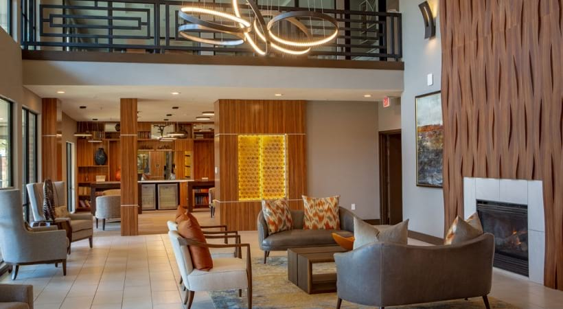 Resident clubhouse with fireplace at 55 plus apartments