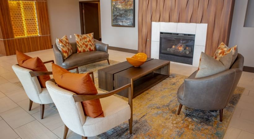 Resident lounge with fireplace at 55 and older apartments