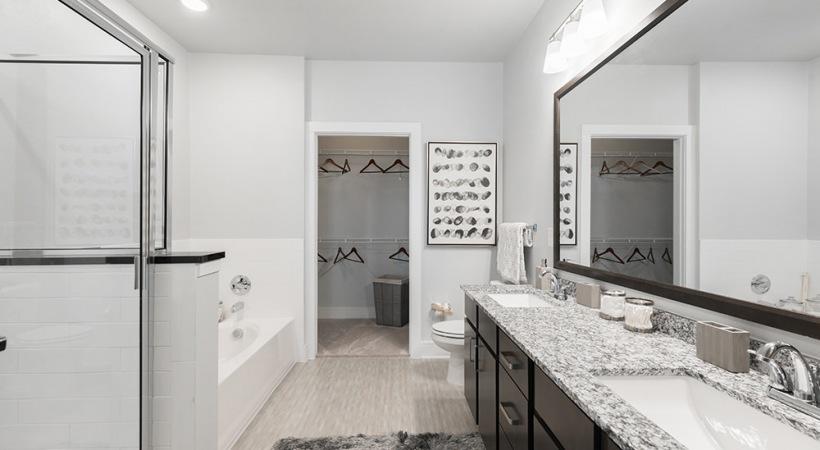 Walk-in shower and double vanities at Cortland Watters Creek
