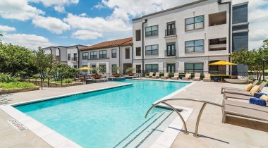 Resort-style pool and sun deck at our Lake Travis apartments