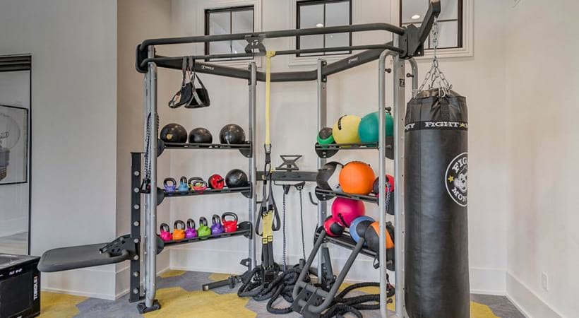 Our Bee Cave apartment gym with punching bag and weights