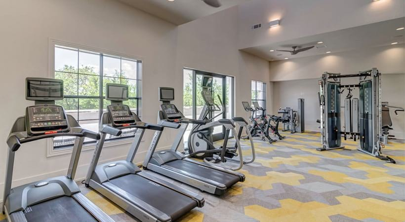 Our Bee Cave apartment gym with treadmills and ceiling fans