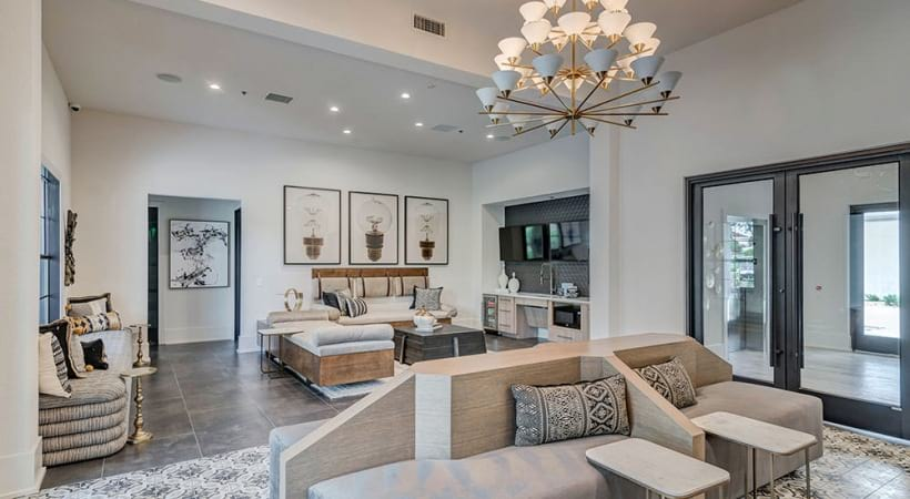 Lounge area with modern decor at our Lake Travis apartment clubhouse