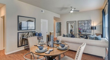 Open-Concept Dining And Living Room With Ceiling Fans At Our Galleria Apartments - Austin, TX
