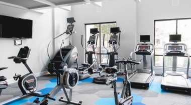 Fitness center with cardio machines and HDTVs