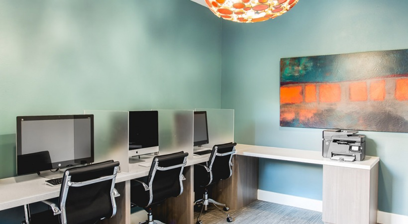 Our Stonebriar apartment business center with work stations and WiFi