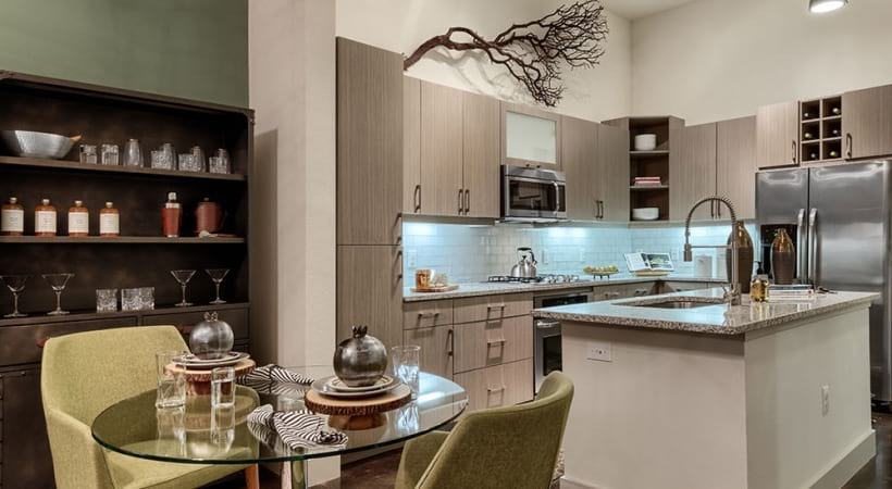 Spacious dining and kitchen area with custom cabinets at apartments for rent in Downtown Dallas, TX