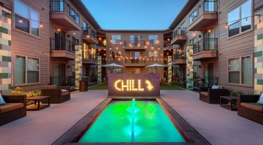 Outdoor lounge with fountain at Dallas apartments