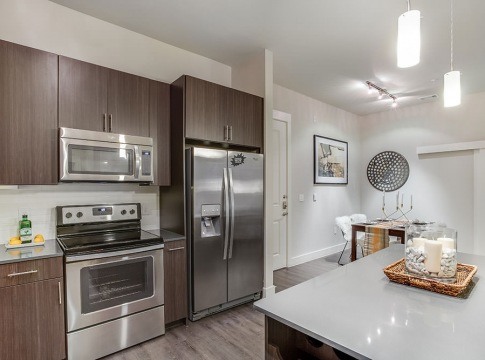 open kitchen with island and ample lighting