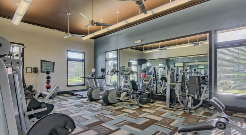 Fitness center at apartments in League City, TX