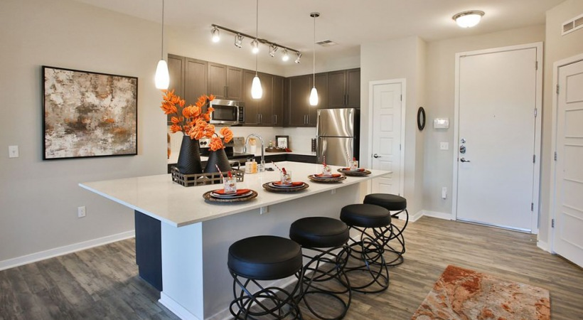 Kitchen with modern lighting at our upscale apartments in Downtown Phoenix