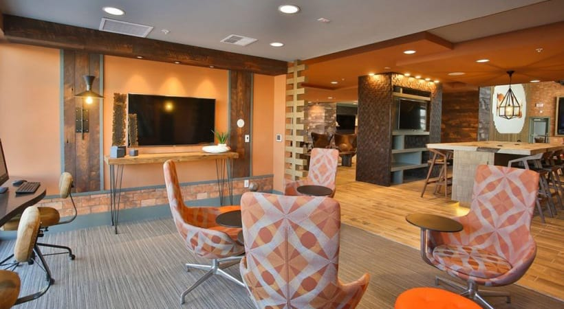 Our Fillmore apartment clubhouse with lounge chairs and HDTV