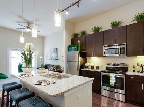 open kitchen with lots of lighting and kitchen island