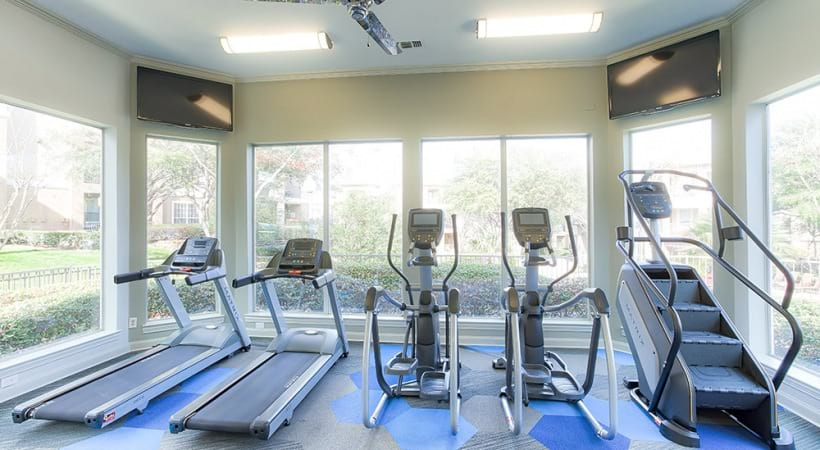 Fitness center with cardio machines at Arbor Hills apartments