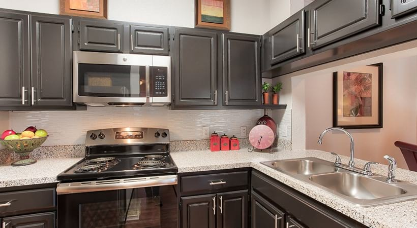 Custom Cabinetry with Designer Tile Backsplash