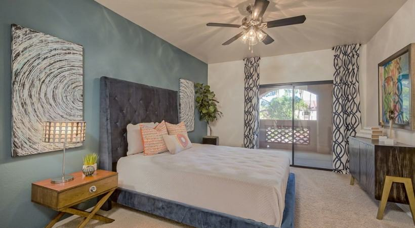 Well Lit Bedroom with Ceiling Fan