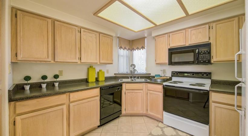 Well Lit Kitchen with Provided Appliances