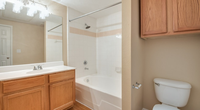 Apartment Bathroom with Deep Soaking Bathtub