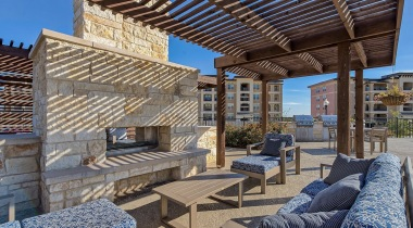Outdoor lounge with fireplace at apartments in San Antonio