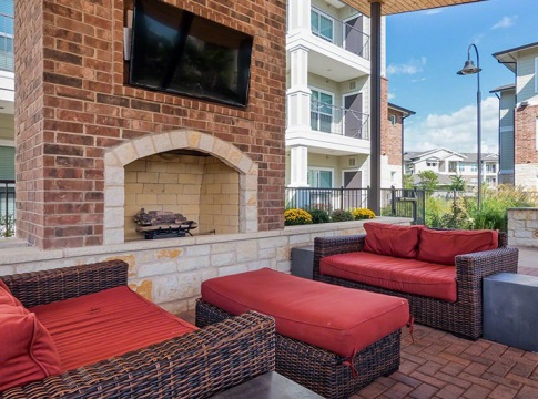 Poolside Lounge with HDTVs and a Fireplace