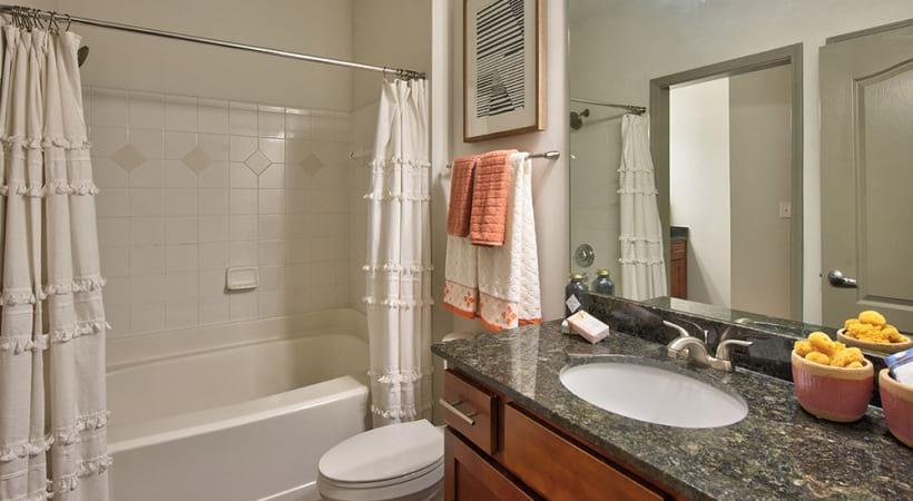 3 bedroom apartment bathroom with deep soaking bathtub