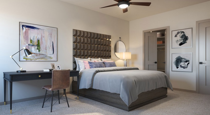 Spacious bedroom with modern decor at our luxury apartments in Downtown Dallas, TX