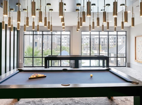 Game Room pool table and floor-to-ceiling windows