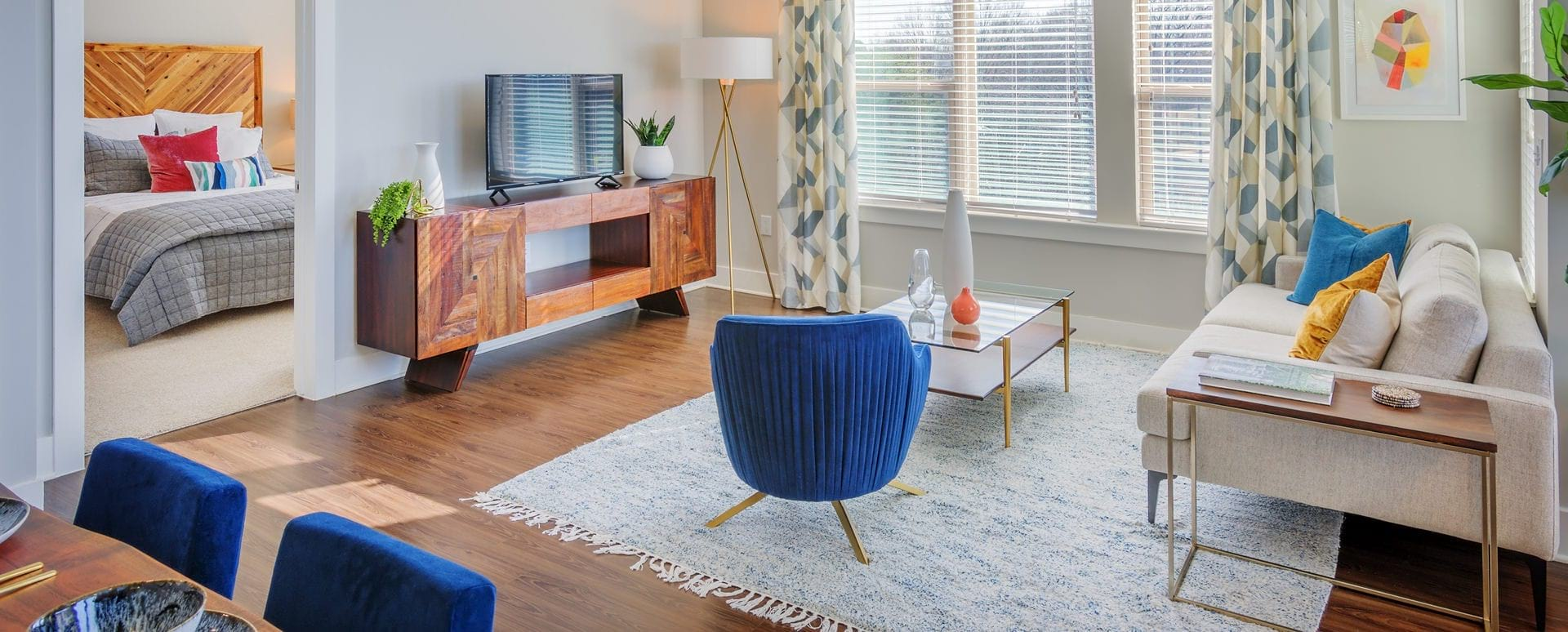 Spacious living room with wide windows at our luxury apartments in Charlotte, NC