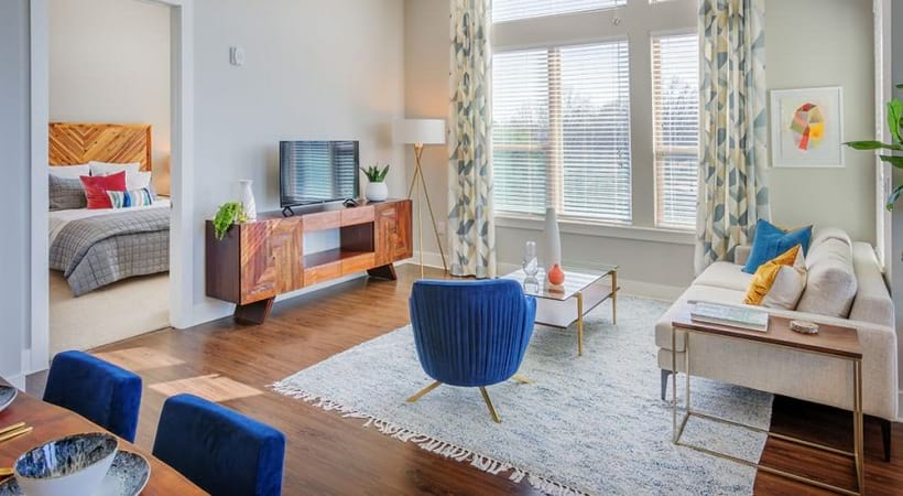 Spacious living room with wood-style flooring at our luxury NoDa apartments
