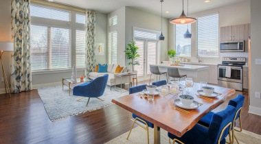 Open concept living room and kitchen at our luxury apartments for rent in NoDa Charlotte, NC