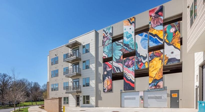 View of residential parking garage with painted mural at Uptown Charlotte apartments