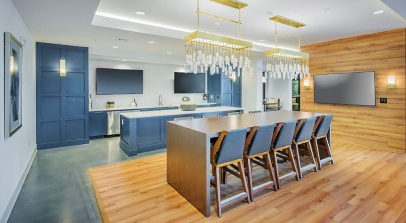 Residential lounge with party-ready kitchen and HDTVs at our luxury Charlotte apartments