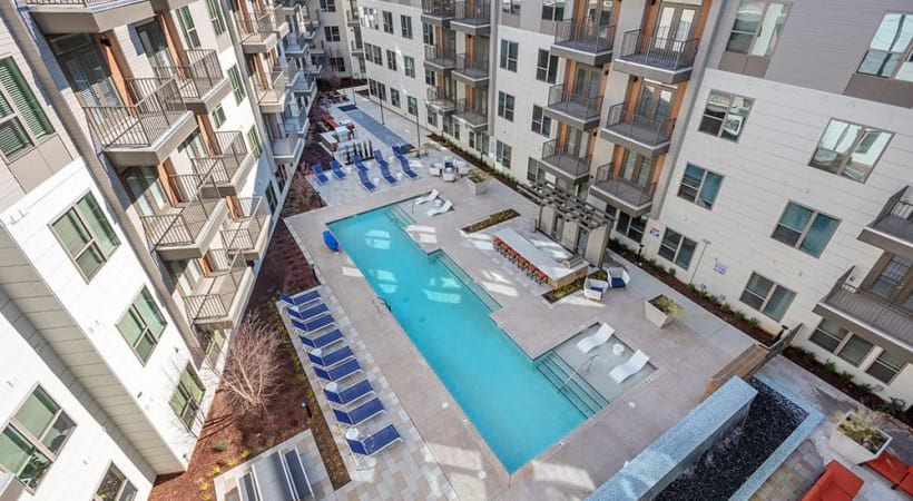 Aerial view of our heated, resort-style pool and sun deck at our Charlotte apartments