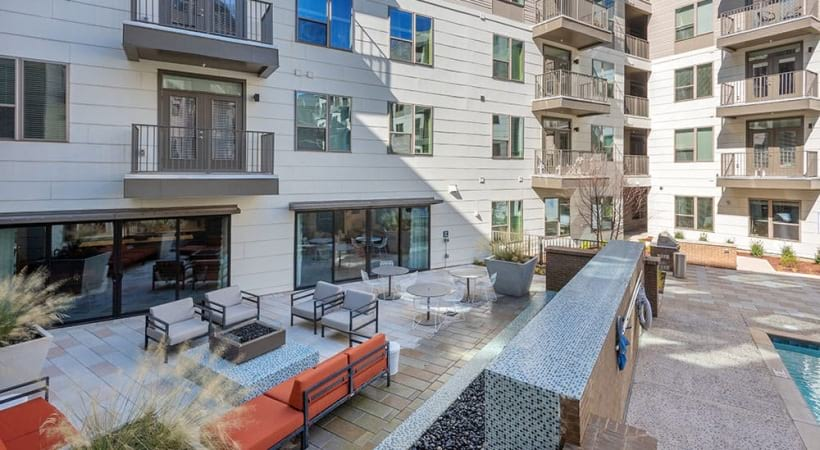 Outdoor kitchen with gas grills at our NoDa Charlotte apartment complex