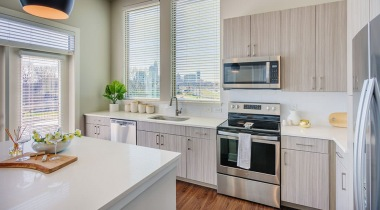 Kitchen with quartz countertops and city skyline views at our NoDa Charlotte apartments
