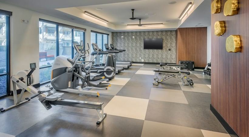 Spacious fitness center with treadmills, rowing machines, and more at our Uptown Charlotte luxury apartments