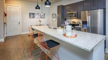 Kitchen with granite countertops and modern cabinetry at our luxury apartments in NoDa Charlotte NC