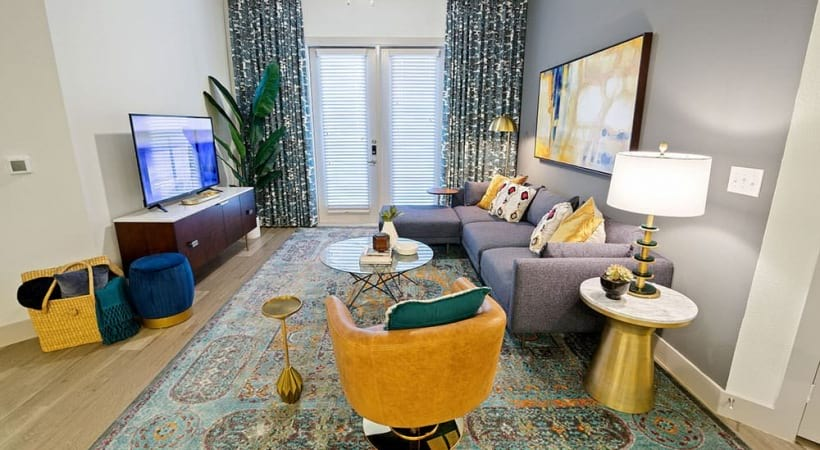 Living room with wood-style flooring at our CityLine apartments in Richardson, TX