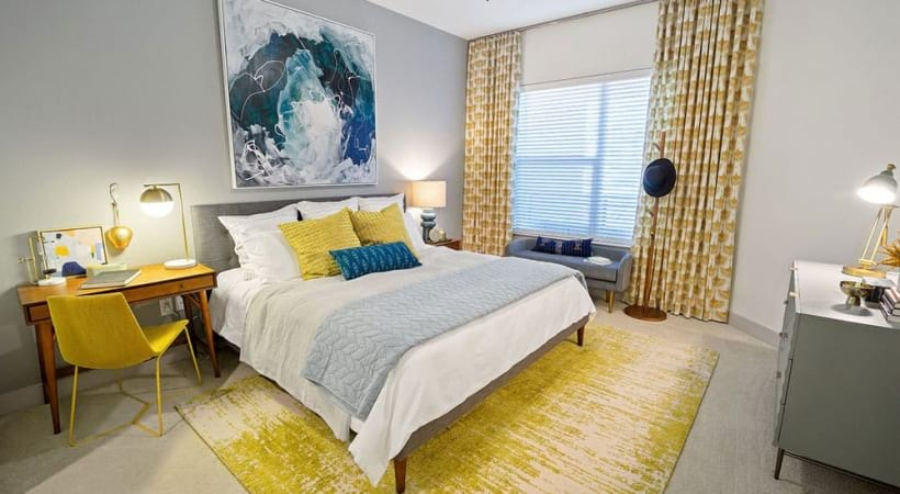 Cozy bedroom with a ceiling fan at our spacious apartments for rent in Dallas, TX