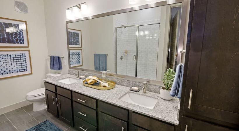 Double sink vanities and granite countertops at Cortland Canyon Creek