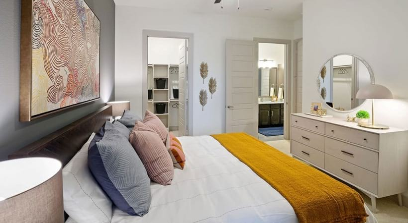 Cozy bedroom with ceiling fans at our CityLine Park apartments in Dallas, TX