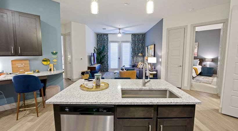 Kitchen island with sink and dishwasher at Cortland Canyon Creek