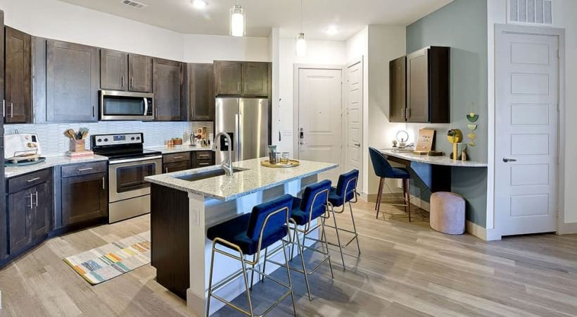 Kitchen island and wood-style flooring at our CityLine apartments in Dallas, TX